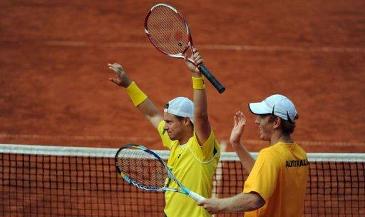 Chris Guccione (R) and Lleyton Hewitt of Australia