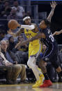 Golden State Warriors' D'Angelo Russell, left, looks to pass away from Orlando Magic's Markelle Fultz (20) during the first half of an NBA basketball game Saturday, Jan. 18, 2020, in San Francisco. (AP Photo/Ben Margot)