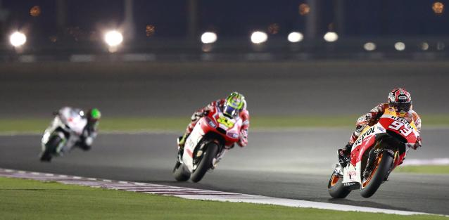 Honda MotoGP rider Marc Marquez (R) of Spain rides his bike during a free practice session at the MotoGP World Championship at the Losail International circuit in Doha March 20, 2014. REUTERS/Mohammed Dabbous (QATAR - Tags: SPORT MOTORSPORT)