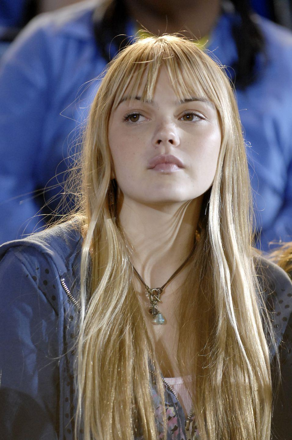 <p>As the coach's daughter, Julie Taylor was the typical small-town teenager who drove her parents crazy. She was also the girlfriend of QB Matt Saracen. </p><p>When the first season of <em>FNL</em> premiered, Aimee Teegarden was a relatively unknown actress with few credits to her name, which included a cameo on Disney Channel's<em> Hannah Montana </em>that same year.</p>