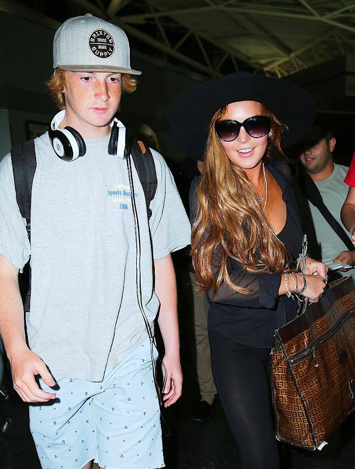 """<p class=""""MsoNormal"""">So much for traveling in style! The 26-year-old<span> </span>was snapped sporting an unfortunate airport ensemble, which included black spandex pants, a sheer blouse, and a floppy hat. Despite her fashion fail, she appeared to be in good spirits as she made her way through JFK with her 16-year-old brother Cody. (8/21/2012)</p>"""