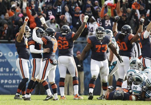 Chicago Bears kicker Robbie Gould (9), second from left, is congratulated by holder Adam Podlesh (8) after Gould kicked a game-winning, 41-yard field goal in the closing seconds to beat the Carolina Panthers 23-22 during an NFL football game in Chicago, Sunday, Oct. 28, 2012. (AP Photo/Nam Y. Huh)
