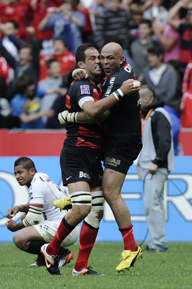 Toulouse's South-African prop Gurthro Steenkamp (R) and Toulouse's French lock Yoann Maestri (L) celebrate after winning the French Top 14 rugby union final match Toulouse vs Toulon, on June 9, 2011 at the Stade de France in Saint-Denis, outside Paris. AFP PHOTO / FRED DUFOURFRED DUFOUR/AFP/GettyImages