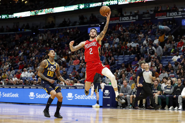New Orleans Pelicans guard Lonzo Ball (2) catches a pass in front of Utah Jazz guard Jordan Clarkson (00) in the first half of an NBA basketball game in New Orleans, Monday, Jan. 6, 2020. (AP Photo/Tyler Kaufman)