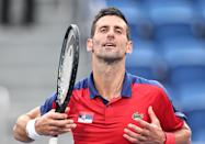 <p>TOKYO, JAPAN - JULY 28: Novak Djokovic of Serbia reacts against Alejandro Davidovich Fokina of Spain during the Men's Singles Third Round Tennis Match on day five of the Tokyo 2020 Olympic Games at Ariake Tennis Park on July 28, 2021 in Tokyo, Japan. (Photo by Wang Xianmin/CHINASPORTS/VCG via Getty Images)</p>