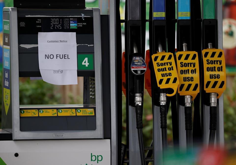 A 'No Fuel' sign is attached to an empty petrol pump at a BP filling station in Manchester (REUTERS)