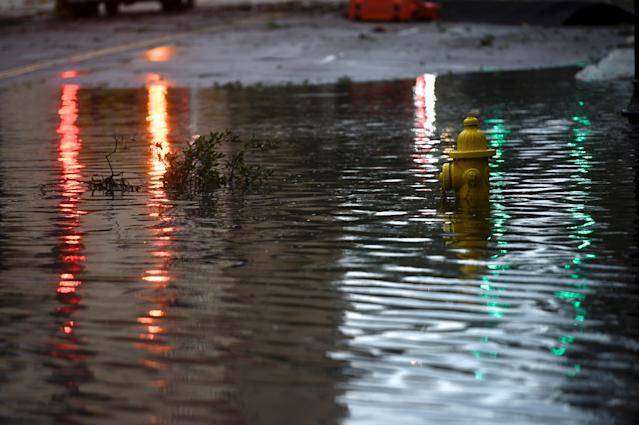 <p>Lights are reflected beside a submerged water hydrant in floodwaters after Hurricane Irma in Jacksonville, Fla. on Sept. 11, 2017. (Photo: Mark Makela/Reuters) </p>