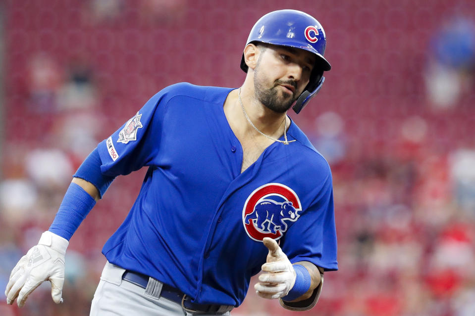 Chicago Cubs' Nicholas Castellanos runs the bases after hitting a solo home run off Cincinnati Reds starting pitcher Alex Wood during the third inning of a baseball game Thursday, Aug. 8, 2019, in Cincinnati. (AP Photo/John Minchillo)