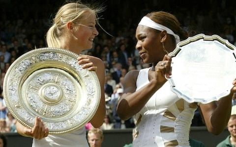 In this Saturday July 3, 2004 file image Russia's Maria Sharapova, left, holds the winner's trophy with Serena Williams holding the runners up trophy after the presentation of the Women's Singles final on the Centre Court at Wimbledon. The fourth-round French Open match between Sunday June 3, 2018, Serena Williams and Maria Sharapova will be their 22nd head-to-head meeting. Williams has won 19 of 21 so far, including 18 in a row. Both of Sharapova's victories came 14 years ago, including in the 2004 Wimbledon final - Credit: AP