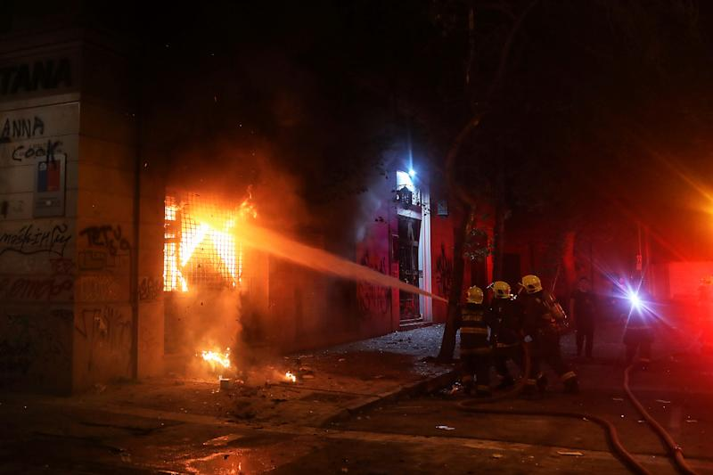 Firemen work to put out flames from a building during an anti-government protest in Santiago, Chile on Oct. 28, 2019. (Photo: Pablo Sanhueza/Reuters)