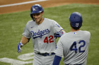Los Angeles Dodgers' Corey Seager, left, is congratulated by Cody Bellinger, right, after a solo home run during the first inning of a baseball game against the Texas Rangers in Arlington, Texas, Sunday, Aug. 30, 2020. (AP Photo/Roger Steinman)