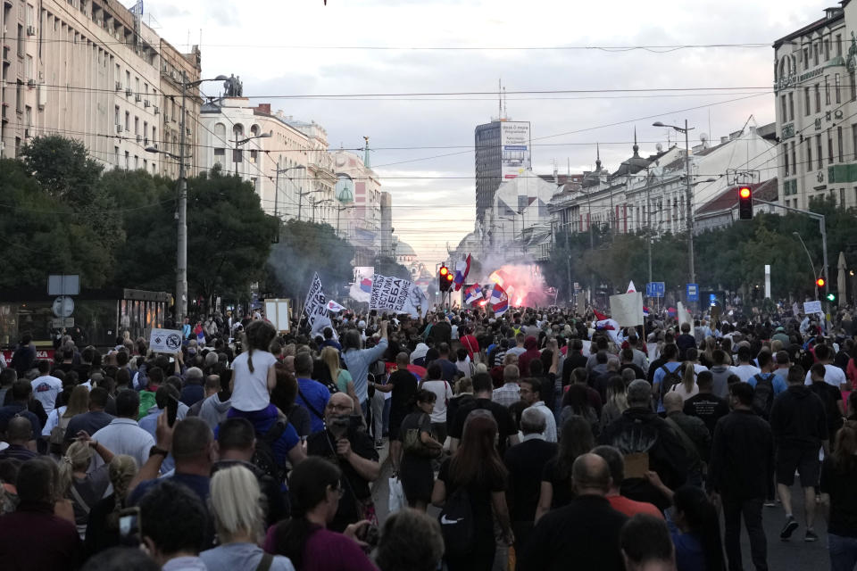 Thousands of demonstrators take the streets to protest potential new COVID-19 restrictions announced by the government in Belgrade, Serbia, Saturday, Sept. 18, 2021. (AP Photo/Darko Vojinovic)