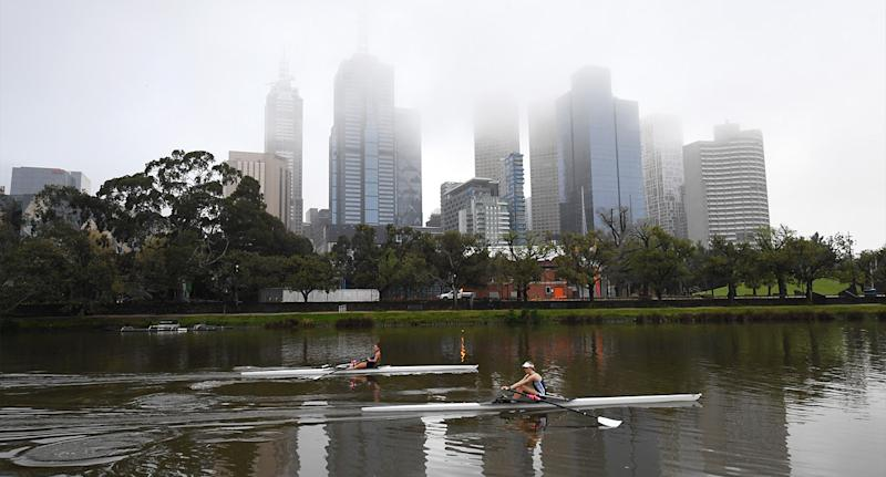 Rowers are seen in action along the Yarra river on a foggy morning in Melbourne, Wednesday. Source: AAP