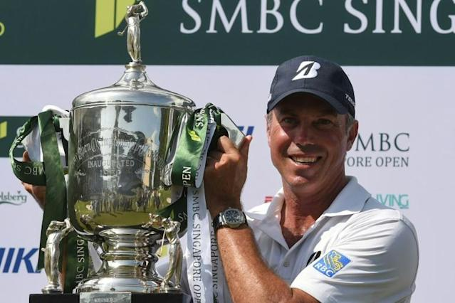 Rio bronze medallist Matt Kuchar won the Singapore Open with a four-day total of 266, three clear of second placed Justin Rose (AFP Photo/Roslan RAHMAN)