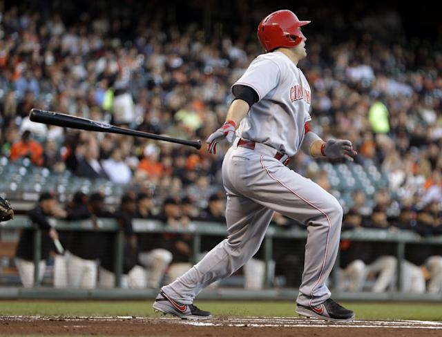 Cincinnati Reds' Joey Votto watches his RBI sacrifice fly off San Francisco Giants' Chad Gaudin in the first inning of a baseball game Wednesday, July 24, 2013, in San Francisco. (AP Photo/Ben Margot)
