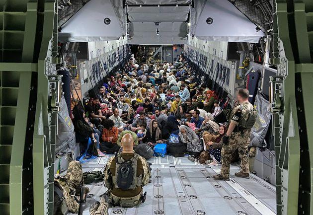 TASHKENT, UZBEKISTAN - AUGUST 22: In this handout image provided by the Bundeswehr,  evacuees from Kabul sit inside a military aircraft as they arrive at Tashkent Airport on August 22, 2021 in Tashkent, Uzbekistan. German Chancellor Merkel said Germany must urgently evacuate up to 10,000 people from Afghanistan for which it is responsible. (Photo by Handout/Bundeswehr via Getty Images) (Photo: Handout via Getty Images)