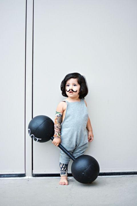 """<p>Your little guy will steal the show in this adorably adapted strong """"little"""" man costume. For his barbell, simply add hot glue to the ends of a wrapping paper tube and insert the tube into two Styrofoam balls. </p><p><strong>See more at <a href=""""http://littleinspiration.com/2015/10/best-of-aw15-guide-sailor-janes-easy-strong-man-costume.html"""" rel=""""nofollow noopener"""" target=""""_blank"""" data-ylk=""""slk:Little Inspiration"""" class=""""link rapid-noclick-resp"""">Little Inspiration</a>. </strong></p><p><a class=""""link rapid-noclick-resp"""" href=""""https://www.amazon.com/Temporary-Sleeves-Hmxpls-Stockings-Accessories/dp/B00IIFSH36?tag=syn-yahoo-20&ascsubtag=%5Bartid%7C10050.g.29402076%5Bsrc%7Cyahoo-us"""" rel=""""nofollow noopener"""" target=""""_blank"""" data-ylk=""""slk:SHOP TATTOO SLEEVES"""">SHOP TATTOO SLEEVES</a></p>"""