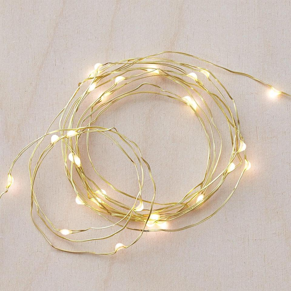 <p>These <span>Twinkle Gold String Lights</span> ($13) will liven up your living room.</p>
