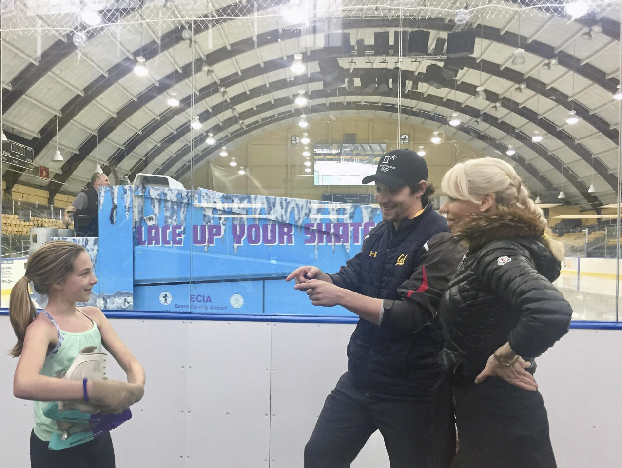 """In this Jan. 30, 2018, photo provided by Championship Figure Skating Camp, figure skater Gabby Rodyk, left, chats with coaches Matel Silecky and Rosie Tovi before taking the ice at the Essex County Codey Arena in West Orange, N.J. Tovi has a better idea. The figure skating coach believes _ and she has many supporters throughout the ice world _ an emphasis on """"happy and healthy"""" should take precedence over turning the sport into gymnastics in a rink. The longtime coach and choreographer calls it a holistic approach. """"Holistic is a perfect word, because it is the whole,"""" says Tovi, who will be launching her Championship Figure Skating Camp at the Essex County Codey Arena in West Orange on June 25. (Martin Rodyk/Championship Figure Skating Camp via AP)"""