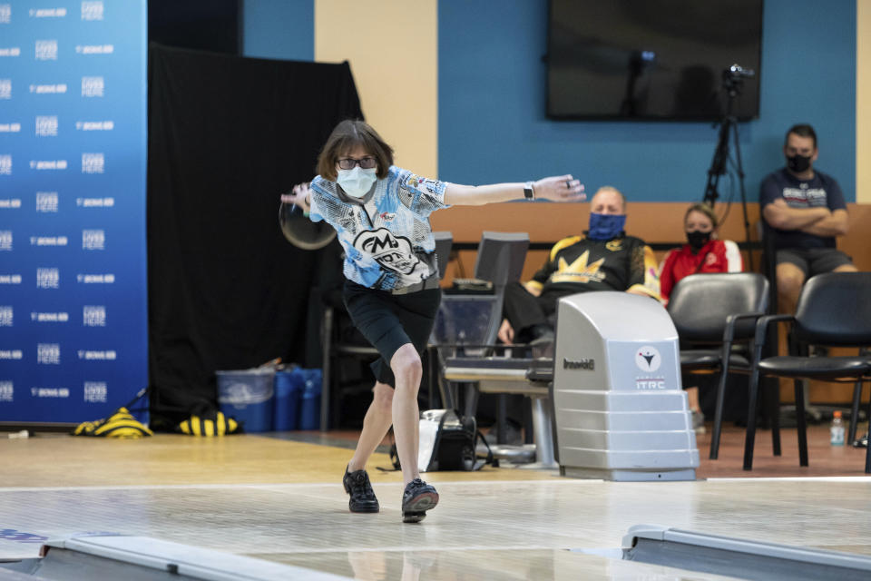 """Critical care nurse and professional bowler Erin McCarthy competes at the 2021 PWBA Kickoff Classic Series in Arlington, Texas, Jan. 26, 2021. """"You have to have a calm demeanor and think clearly,"""" McCarthy says. """"I think that's probably why I love doing them both equally as much."""" (USBC via AP)"""