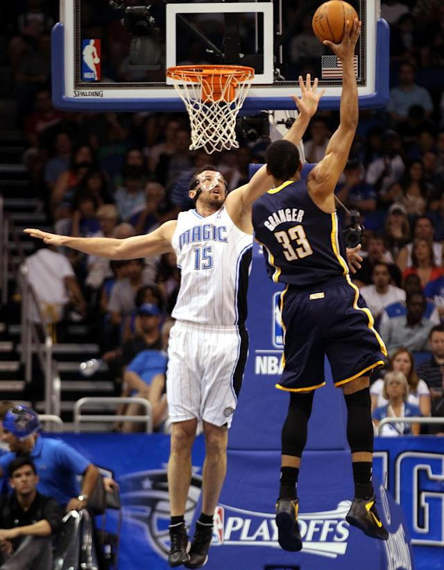 ORLANDO, FL - MAY 05: Forward Danny Granger #33 of the Indiana Pacers shoots against Forward Hedo Turkoglu #15 of the Orlando Magic in Game three of the Eastern Conference Quarterfinals in the 2012 NBA Playoffs at Amway Center on May 5, 2012 in Orlando, Florida. The Pacers defeated the Magic 97-74. NOTE TO USER: User expressly acknowledges and agrees that, by downloading and or using this photograph, User is consenting to the terms and conditions of the Getty Images License Agreement. (Photo by Marc Serota/Getty Images)