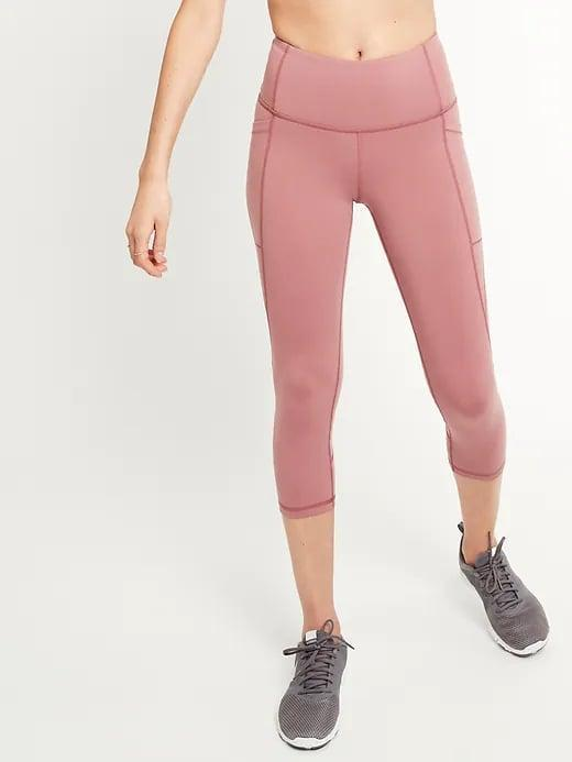 <p>Choose a pair of <span>Old Navy High-Waisted Elevate Side-Pocket Compression Crops</span> ($16-$18, originally $33) to keep it all together when things heat up during your next intense workout.</p>