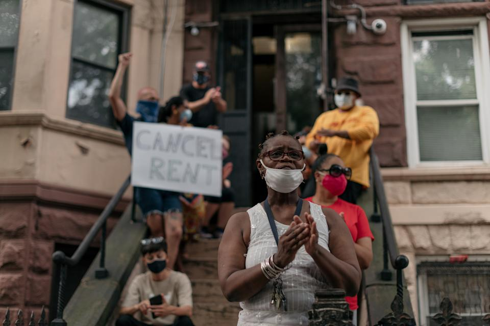 NEW YORK, NY - JULY 31: Housing activists gather to protest alleged tenant harassment by a landlord and call for cancellation of rent in the Crown Heights neighborhood on July 31, 2020 in Brooklyn, New York. Since the onset of the coronavirus crisis, millions of Americans have fallen behind on rent payments, leading many to speculate that an eviction crisis and drastic rise in homelessness is inevitable unless drastic action is taken by state and federal lawmakers. (Photo by Scott Heins/Getty Images)