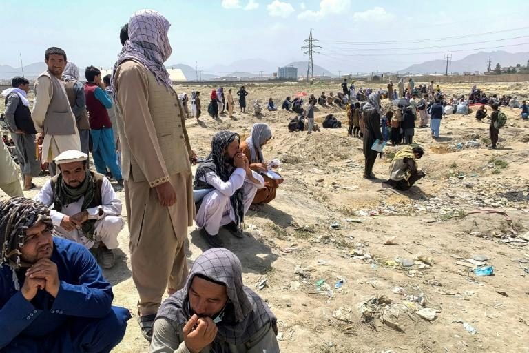 Thousands of Afghans have gathered at Kabul airport, desperate to seize the chance to flee life under the newly returned Taliban