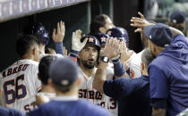 Houston Astros' Robinson Chirinos celebrates in the dugout after hitting a three-run home run against the Oakland Athletics during the seventh inning of a baseball game Monday, Sept. 9, 2019, in Houston. (AP Photo/David J. Phillip)