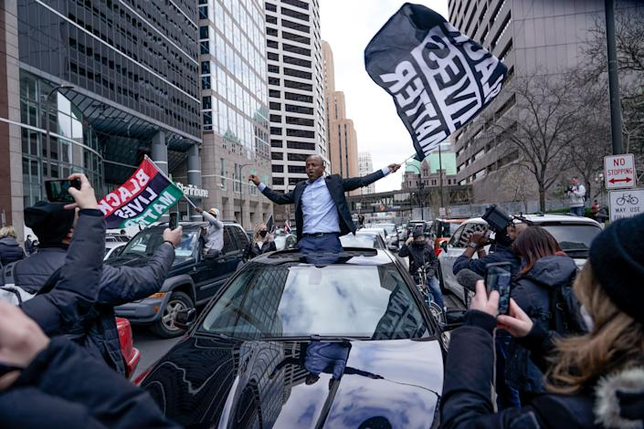 <p>People rally outside the courthouse in Minneapolis on 20 April, 2021, after the guilty verdicts were announced in the trial of former Minneapolis police officer Derek Chauvin in the death of George Floyd</p> (AP)