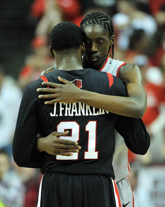 LAS VEGAS, NV - MARCH 15: Jamaal Franklin #21 of the San Diego State Aztecs is embraced at center court by Tony Snell #21 of the New Mexico Lobos after New Mexico won 60-50 in a semifinal game of the Reese's Mountain West Conference Basketball tournament at the Thomas & Mack Center on March 15, 2013 in Las Vegas, Nevada. (Photo by Jeff Bottari/Getty Images)
