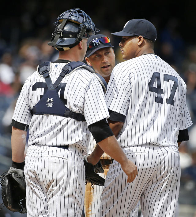 New York Yankees shortstop Derek Jeter, center, and Yankees catcher Brian McCann (34) talk to Yankees starting pitcher Ivan Nova (47) on the mound after Nova allowed three runs in the fourth inning of a baseball game against the Baltimore Orioles at Yankee Stadium in New York, Tuesday, April 8, 2014. New York Yankees manager Joe Girardi took Nova out of the game moments later. (AP Photo/Kathy Willens)