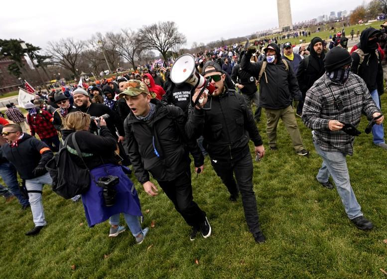 Ethan Nordean leads members of the far-right group Proud Boys in marching before the riot at the U.S. Capitol.