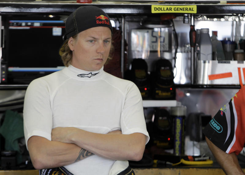 Kimi Raikkonen, of Finland, waits for practice for Saturday's NASCAR Nationwide series Top Gear 300 auto race in Concord, N.C., Thursday, May 26, 2011. (AP Photo/Chuck Burton)