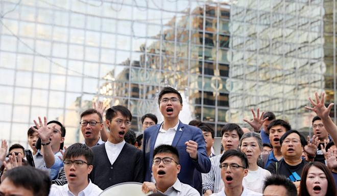 Pro-democracy camp members rally outside the campus of Hong Kong's Polytechnic University on November 25. Photo: Reuters