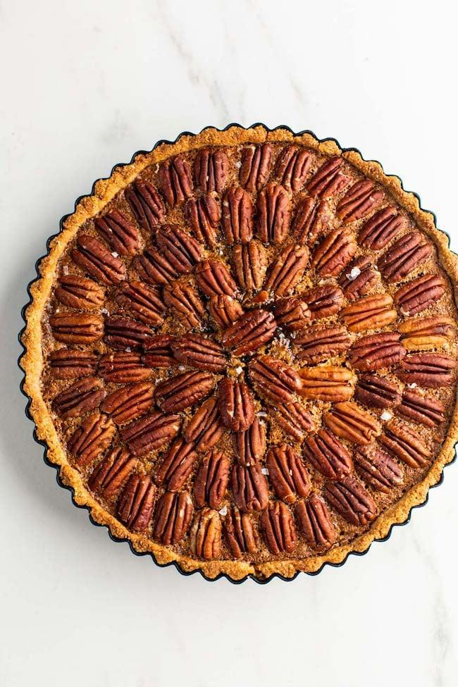 "<p>Pie is a must at Thanksgiving, and this gluten-free and paleo version of a traditional pecan pie is worth the time to make. After munching on this on Thanksgiving, wrap up the leftovers in plastic wrap and foil to freeze for later on in the holiday season. </p><p><strong>Get the recipe:</strong> <a href=""http://www.asaucykitchen.com/gluten-free-pecan-pie-paleo/"" class=""link rapid-noclick-resp"" rel=""nofollow noopener"" target=""_blank"" data-ylk=""slk:gluten-free pecan pie"">gluten-free pecan pie</a></p>"