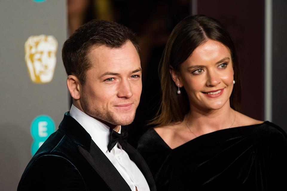 Taron Egerton and Emily Thomas attend the EE British Academy Film Awards at Royal Albert Hall on February 10, 2019 in London, England. (Photo by Jeff Spicer/Getty Images)