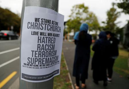 A sign is seen after Friday's mosque attacks outside a community center near Masjid Al Noor in Christchurch, New Zealand, March 16, 2019. REUTERS/Jorge Silva/Files