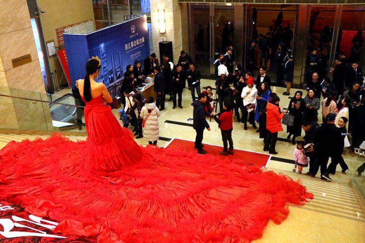 A model wears the insanely luxurious red gown.