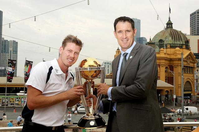 MELBOURNE, AUSTRALIA - FEBRUARY 14: Australian cricketer James Faulkner (L) and Chief Executive Officer of Cricket Australia James Sutherland pose with the ICC Cricket World Cup during the media opportunity as the one year to go countdown begins until the 2015 ICC Cricket World Cup at Federation Square on February 14, 2014 in Melbourne, Australia. (Photo by Graham Denholm/Getty Images for the ICC)