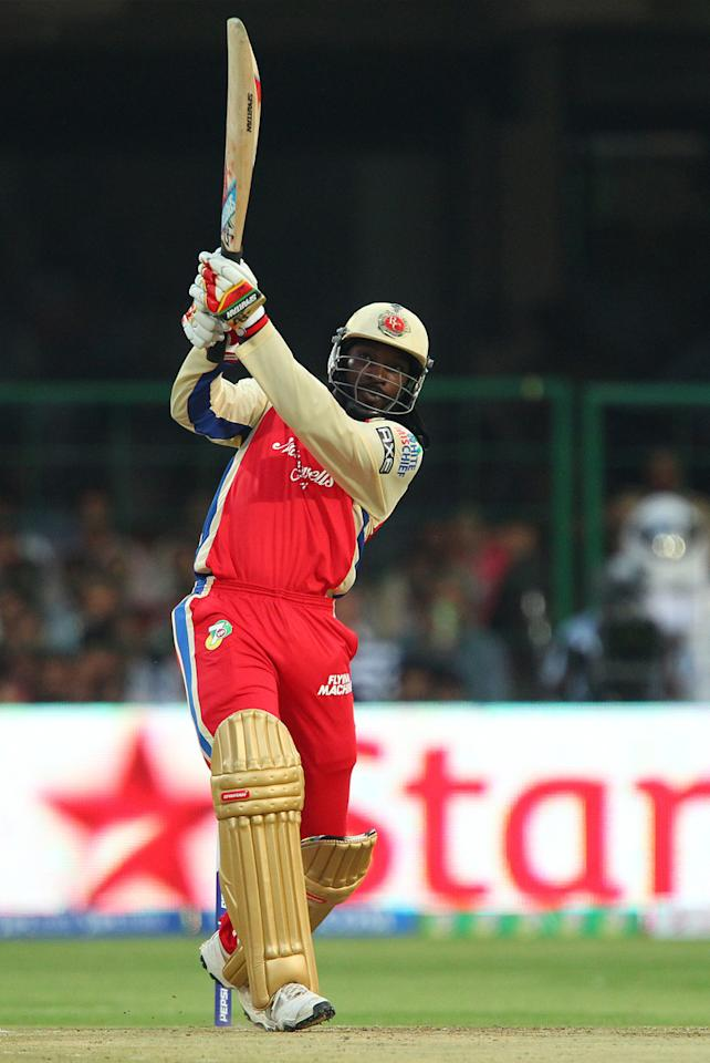 Chris Gayle smashes Ryan McLaren for six during match 12 of the Pepsi Indian Premier League between The Royal Challengers Bangalore and The Kolkata Knight Riders  held at the M. Chinnaswamy Stadium, Bengaluru  on the 11th April 2013..Photo by Ron Gaunt-IPL-SPORTZPICS   ..Use of this image is subject to the terms and conditions as outlined by the BCCI. These terms can be found by following this link:..https://ec.yimg.com/ec?url=http%3a%2f%2fwww.sportzpics.co.za%2fimage%2fI0000SoRagM2cIEc&t=1495913751&sig=JYGNU6RmVW57irwqfgypJQ--~C