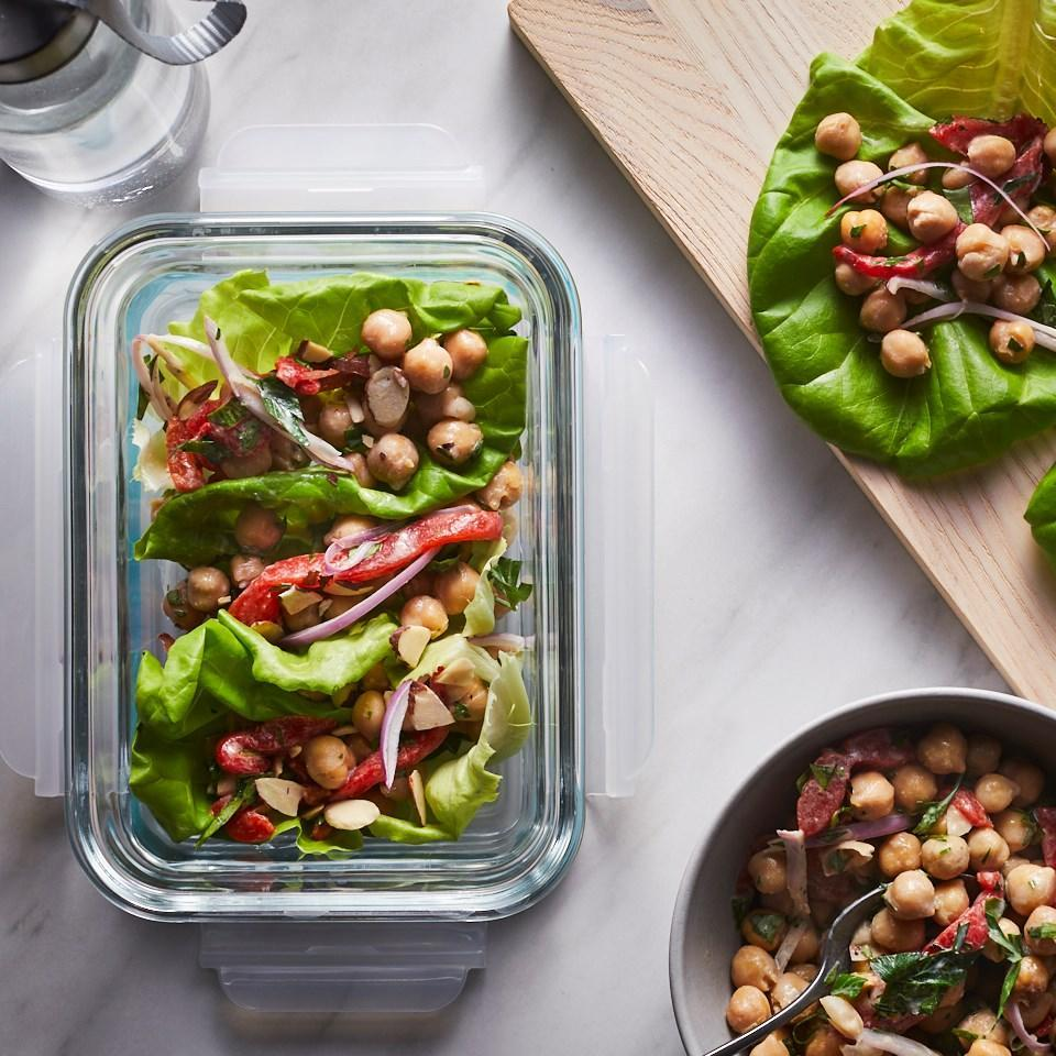 """<p>A tangy, nutty tahini dressing brings together no-cook ingredients like canned chickpeas and roasted red peppers for these easy meal-prep lettuce wraps. Make these wraps ahead of time for a grab-and-go lunch or dinner. A few wedges of warm pita finish off the meal perfectly. <a href=""""https://www.eatingwell.com/recipe/269835/mediterranean-lettuce-wraps/"""" rel=""""nofollow noopener"""" target=""""_blank"""" data-ylk=""""slk:View Recipe"""" class=""""link rapid-noclick-resp"""">View Recipe</a></p>"""