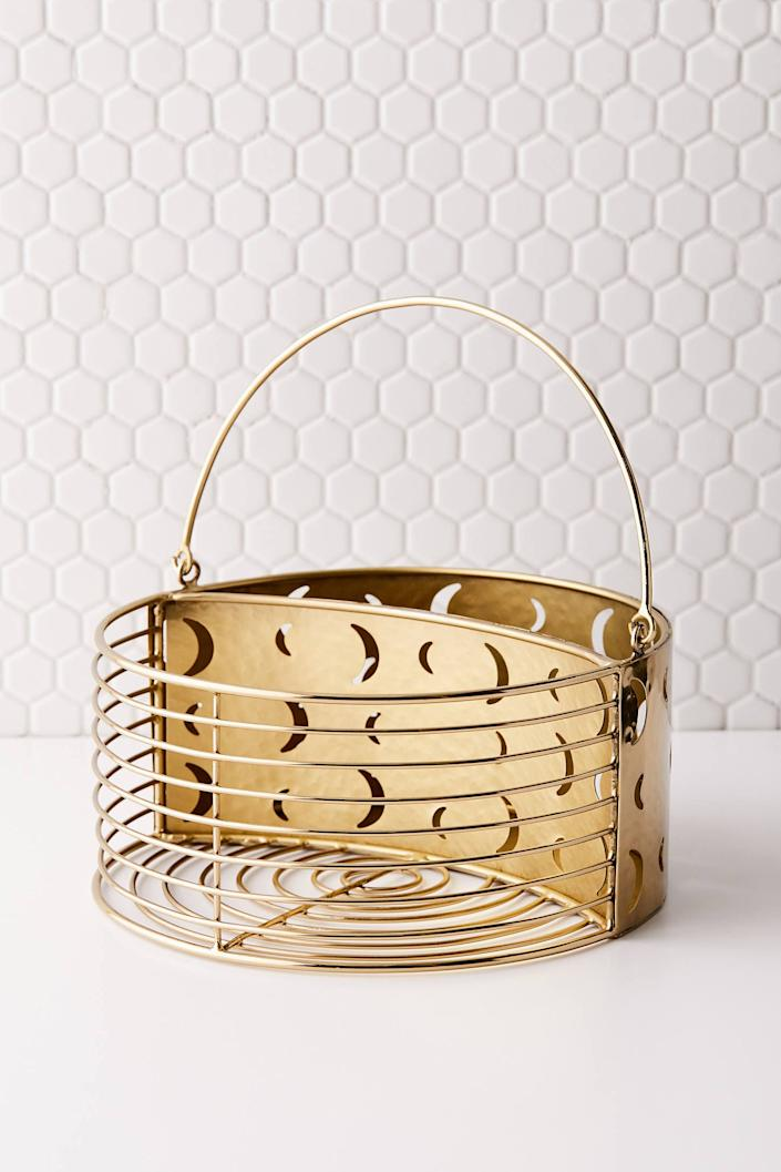 "<h3><a href=""https://www.urbanoutfitters.com/shop/cosmic-shower-caddy"" rel=""nofollow noopener"" target=""_blank"" data-ylk=""slk:Urban Outfitters Cosmic Shower Caddy"" class=""link rapid-noclick-resp""><strong>Urban Outfitters</strong> Cosmic Shower Caddy</a></h3> <p>Channel major celestial vibes with this plated brass basket, which features whimsical moon print detailing and two compartments to organize all your stuff.</p> <br> <br> <strong>Urban Outfitters</strong> Cosmic Shower Caddy, $39, available at <a href=""https://www.urbanoutfitters.com/shop/cosmic-shower-caddy"" rel=""nofollow noopener"" target=""_blank"" data-ylk=""slk:Urban Outfitters"" class=""link rapid-noclick-resp"">Urban Outfitters</a>"