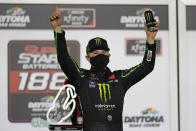 Ty Gibbs celebrates in Victory Lane after winning the NASCAR Xfinity Series road course auto race at Daytona International Speedway, Saturday, Feb. 20, 2021, in Daytona Beach, Fla. (AP Photo/John Raoux)