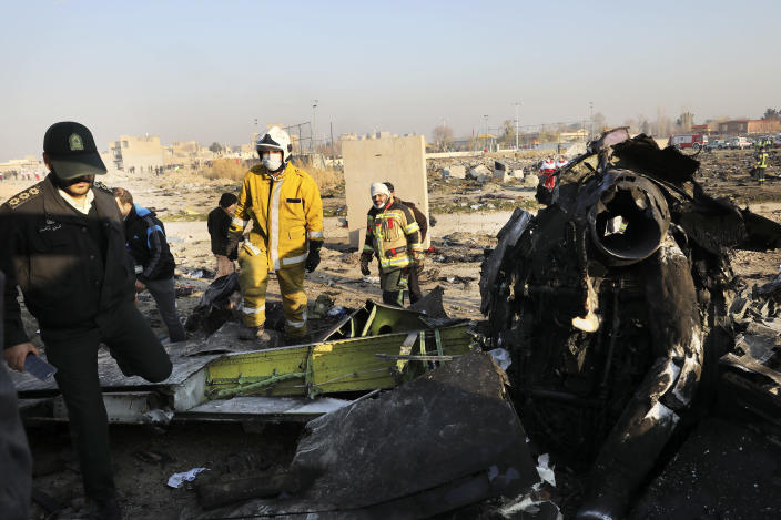 Debris is seen from an Ukrainian plane which crashed as authorities work at the scene in Shahedshahr southwest of the capital Tehran, Iran, Wednesday, Jan. 8, 2020. (Photo: Ebrahim Noroozi/AP)