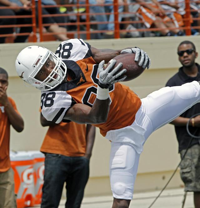 Texas receiver Montrel Meander comes down with a pass during the first half of Texas' Orange and White spring NCAA college football game, Saturday, April 19, 2014, in Austin, Texas. (AP Photo/Michael Thomas)