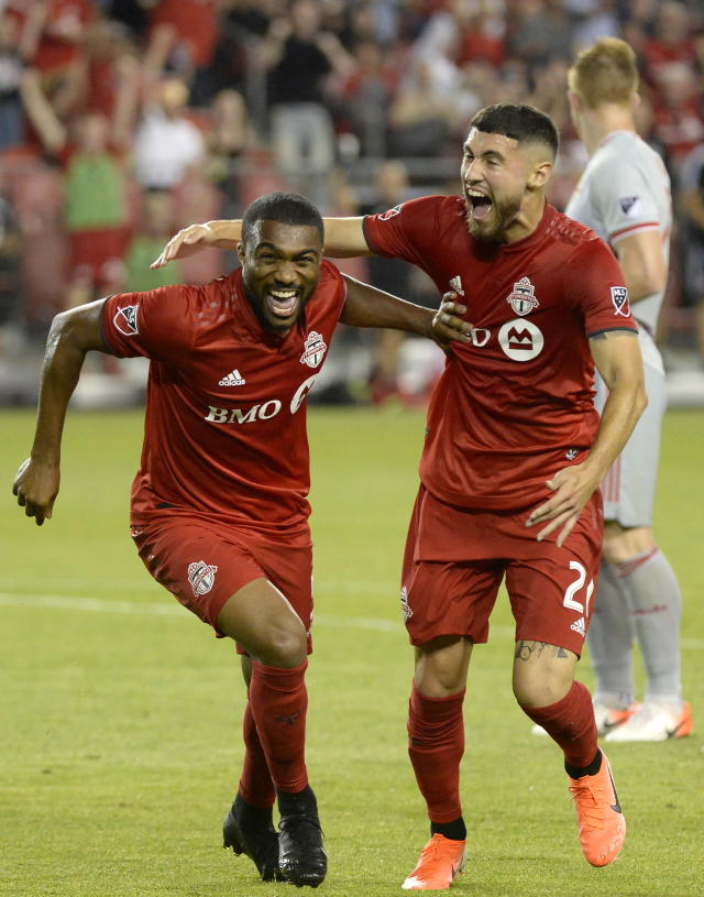 Toronto FC defender Ashtone Morgan (5) celebrates his goal with Jonathan Osorio (21) during the second half of an MLS soccer match against the New York Red Bulls on Wednesday, July 17, 2019, in Toronto. (Nathan Denette/The Canadian Press via AP)