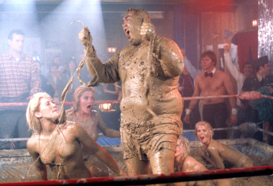 John Candy gets muddy in the famous mud wrestling scene from 'Stripes' (Photo: Courtesy Everett Collection)