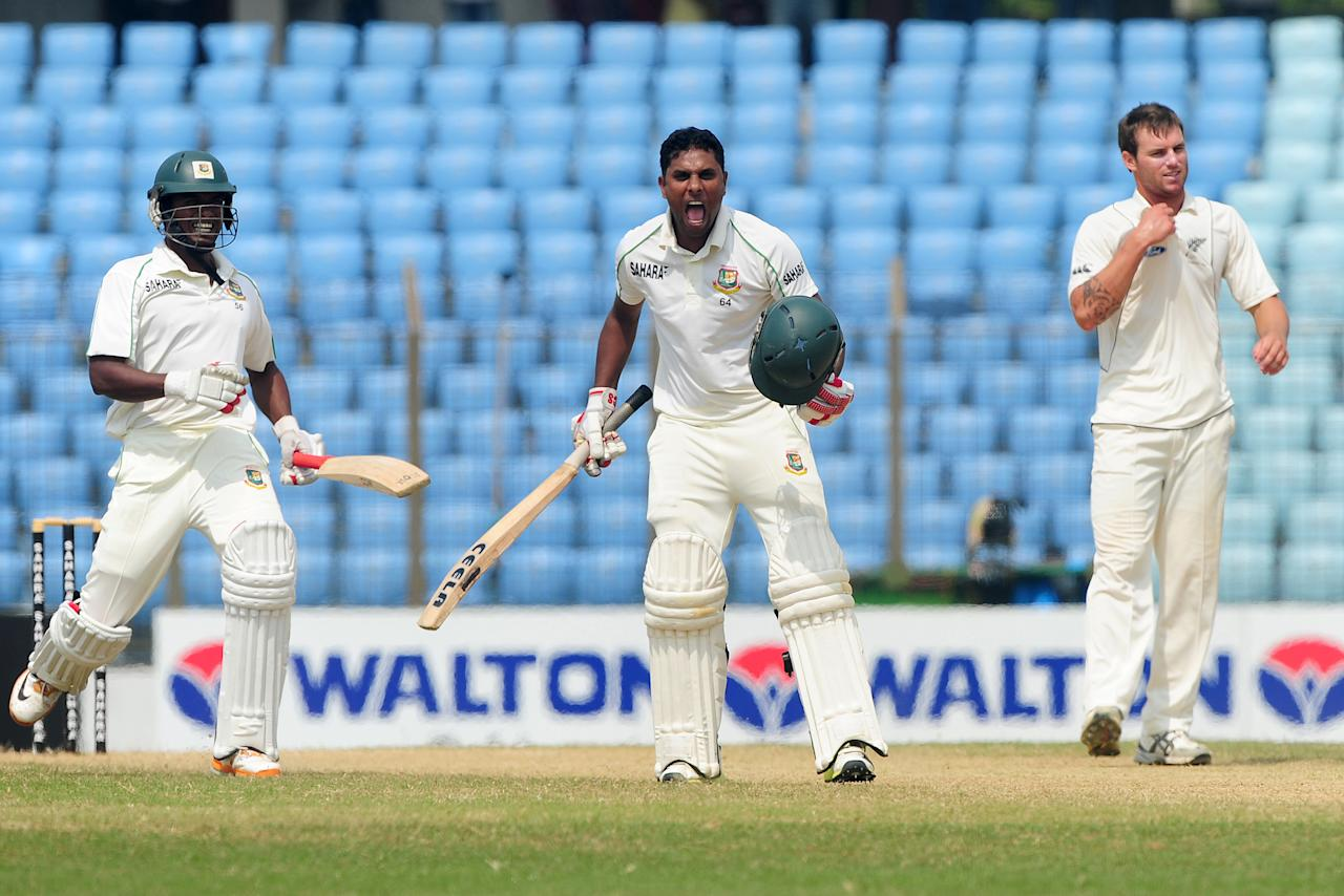 Bangladesh batsman Sohag Gagi (C) reacts after scoring a century (100 runs) as teammate Rubel Hossain (L) and New Zealand bowler Doug Bracewell (R) look on during the fourth day of the first cricket Test match between Bangladesh and New Zealand at The Zahur Ahmed Chowdhury Stadium in Chittagong on October 12, 2013. AFP PHOTO/Munir uz ZAMAN        (Photo credit should read MUNIR UZ ZAMAN/AFP/Getty Images)