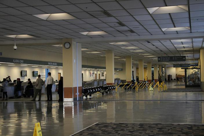 A nearly empty lobby at the North Terminal of the Ted Stevens Anchorage International Airport in Anchorage, Alaska, is shown Tuesday, Jan. 28, 2020. 2
